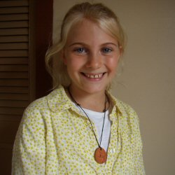 child wearing a Terra Cotta Pendant