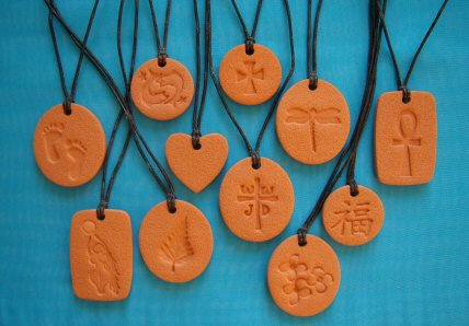 11 of the many Terra Cotta Pendant diffuser necklaces